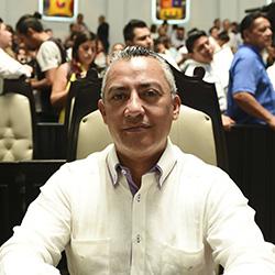 El hijo de Mario Villanueva, Carlos Mario, secretario